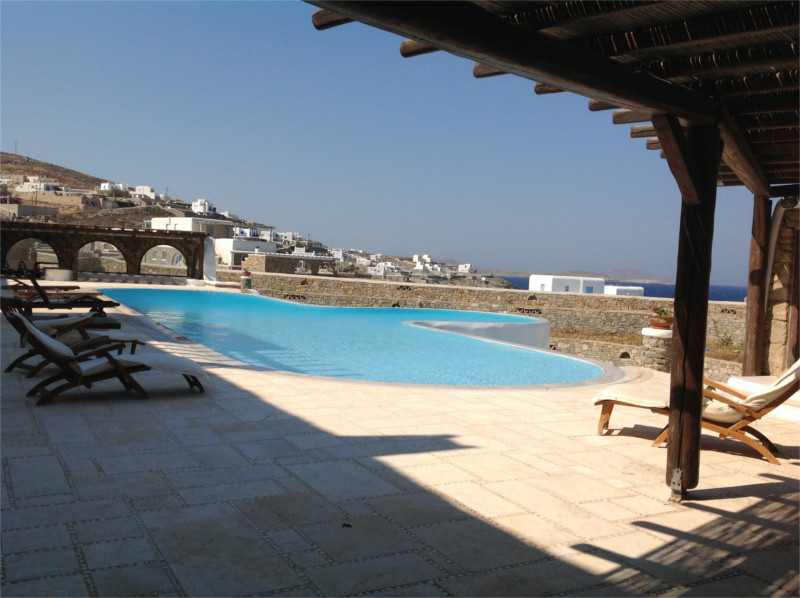 Sofia's studios outdoor veranda with open air view of the Aegean, islands Rhenia and Delos