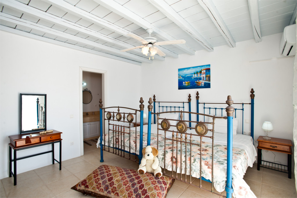 Spacious children's bedroom with two beds